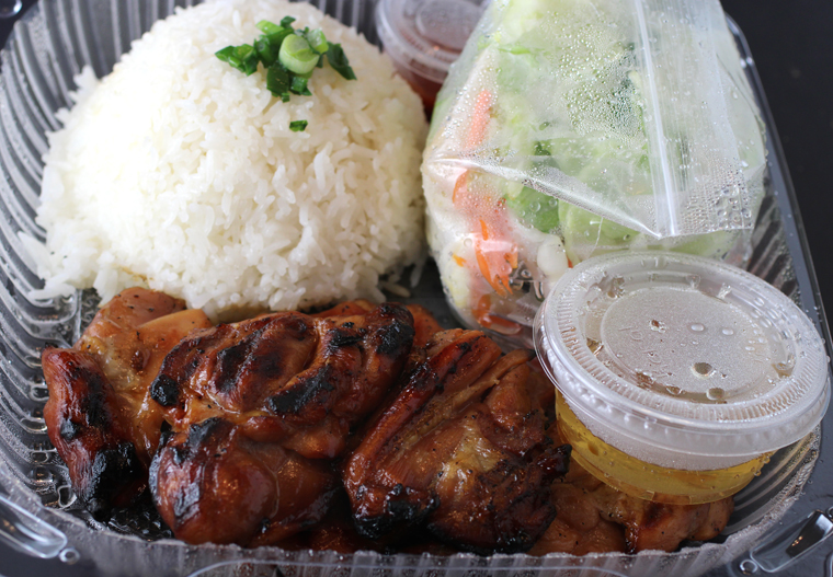 A rice plate with barbecued chicken.