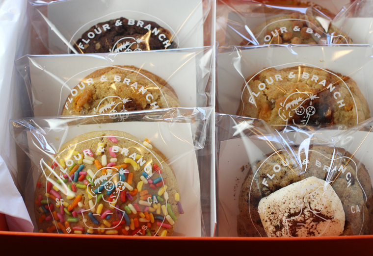 A gift box of cookies, all individually wrapped inside.