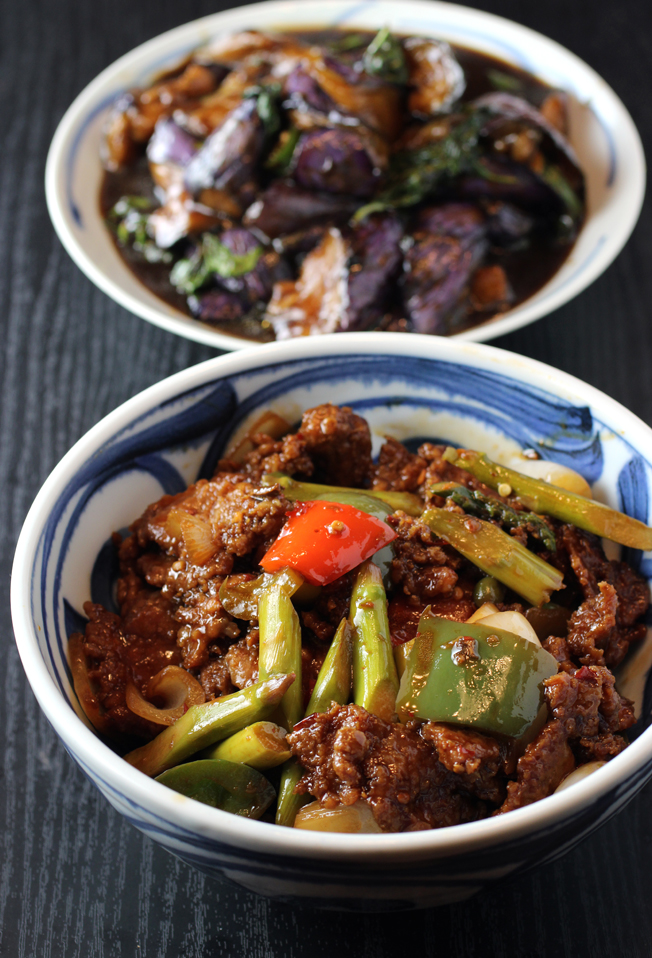 Szechuan beef (front), and basil with eggplant (back).