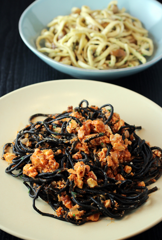 Squid ink pasta (front), and a dish of thick, hand-cut noodles with porcini (back).