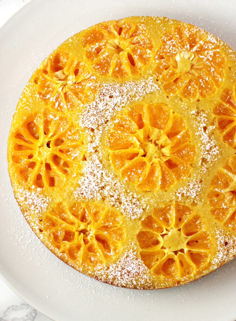 Sliced clementines decorate the top of this upside-down cake so very prettily.