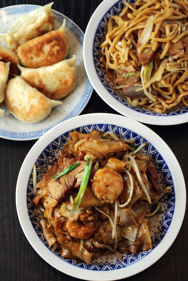 (Clockwise from top): Pork pot stickers, barbecue pork chow mein, and combination chow fun.