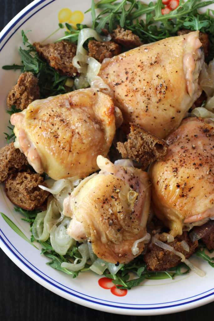 "A ""no-recipe'' recipe of crispy-skin chicken on a bed of caramelized onions and shallots, with arugula and home-made croutons."