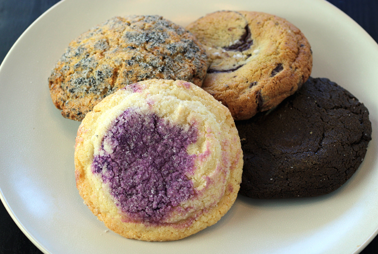 (Clockwise from top left): Black sesame snickerdoodle, chocolate chip, hojicha double chocolate, and coconut ube sugar cookies.