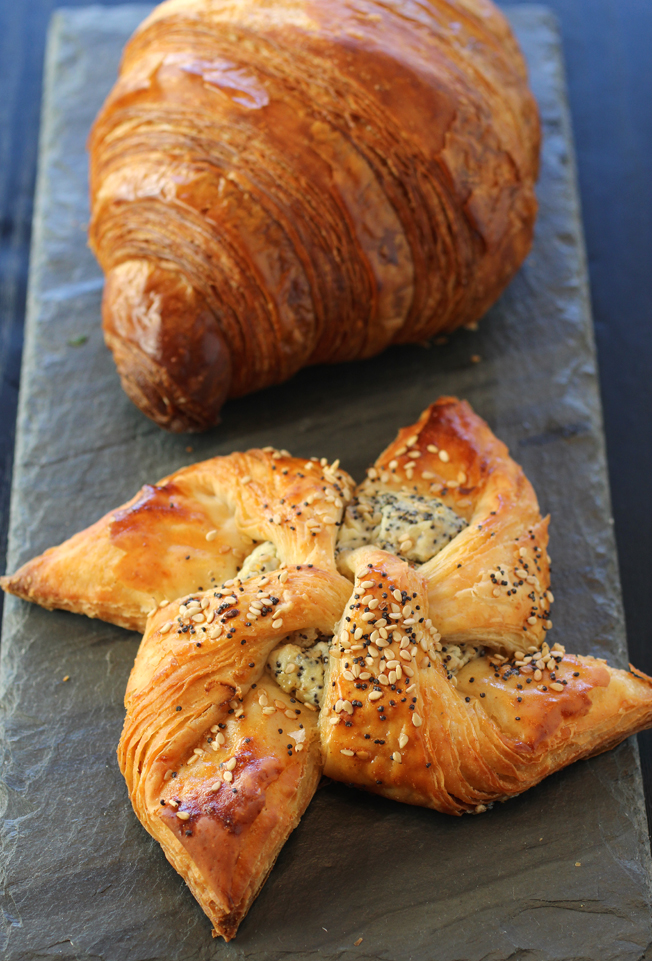 A classic croissant (back) and the everything pinwheel (front).