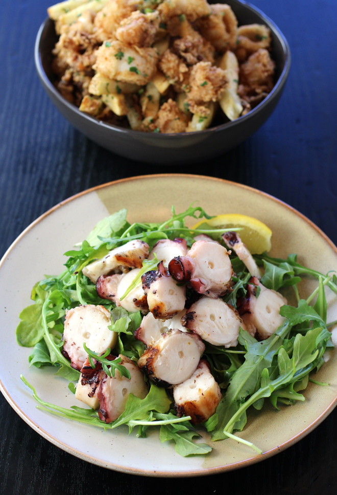 Octopus mezzes (front) and fried calamari with garlic fries (back).