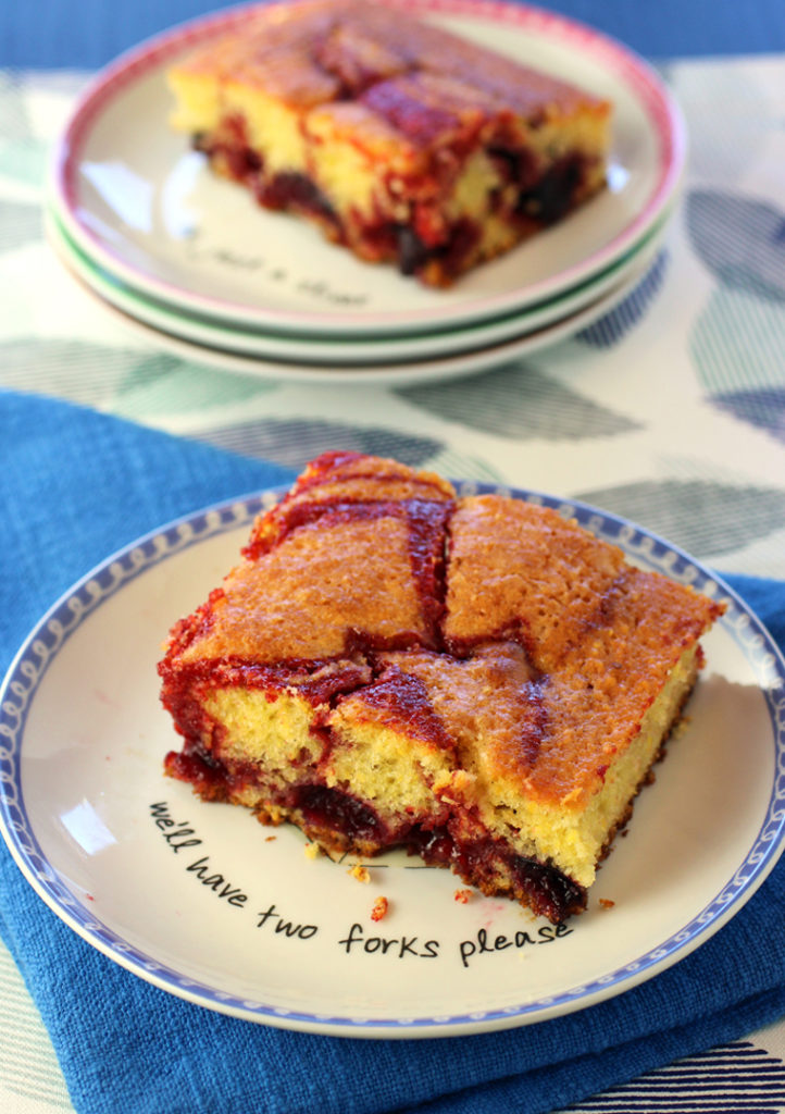 An easy one-pan cake made with fresh cherries and swirls of cherry curd.