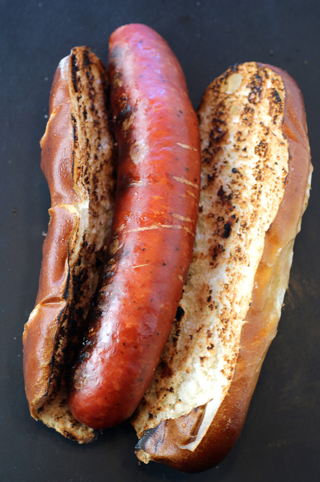 Smoked Andouille boar sausage just off the grill and snuggled in a bun at home.