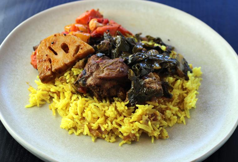 Stewed chicken with collards, plus side veggies.