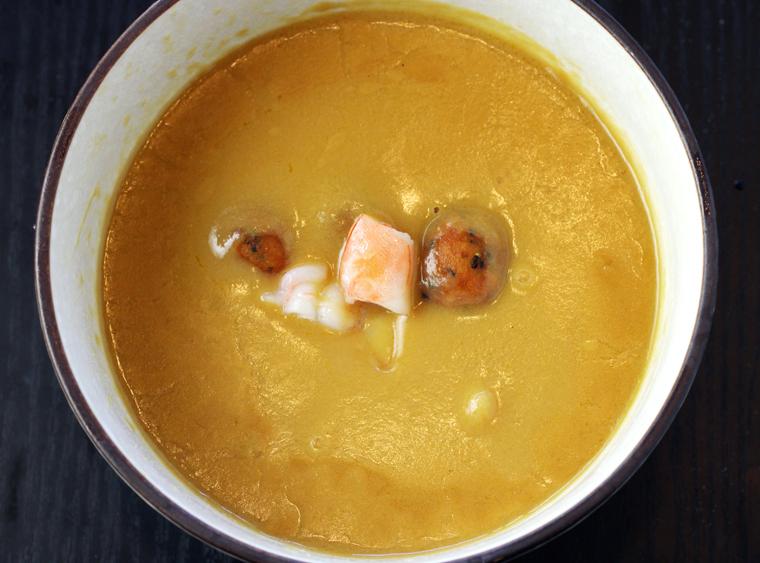 Corn chowder with poached prawns.