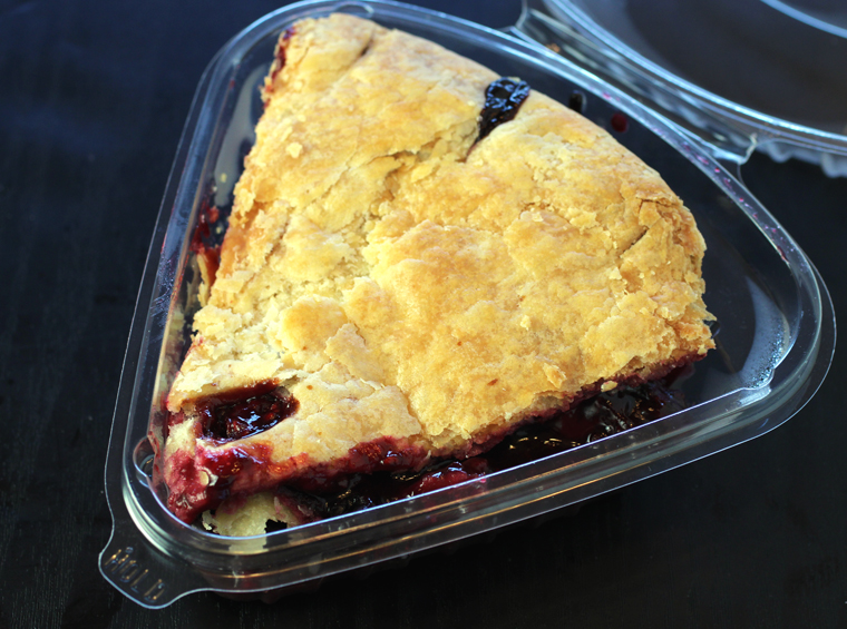 A slice of Real Pie Company's Jumbleberry pie to-go.