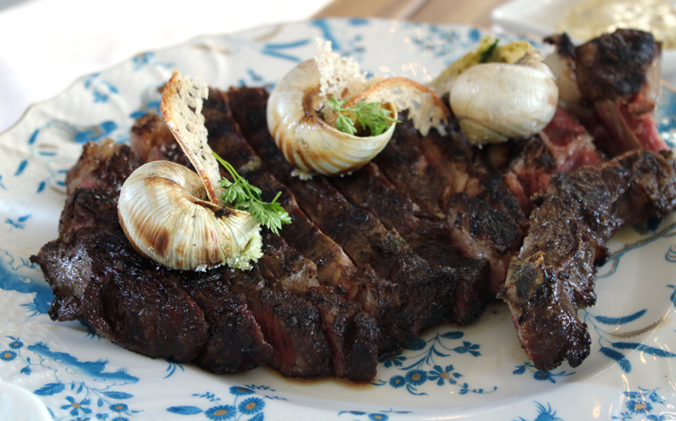 Ribeye with compound butter-filled escargot shells.