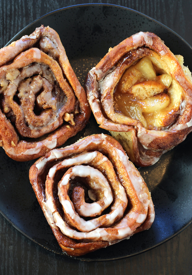 (Clockwise from top): Walnut, apple, and regular cinnamon rolls from Spinners.