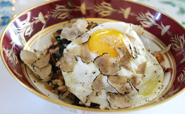 Fried rice with a truffled egg on top.