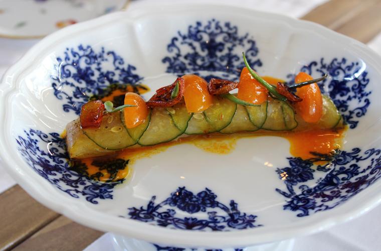 Hamachi crudo served on a Richard Ginori pedestal plate.