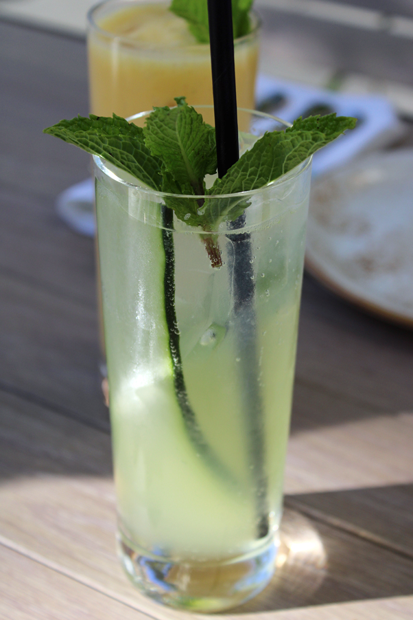 A refreshing non-alcoholic cucumber cooler; and a mango lassi behind it.