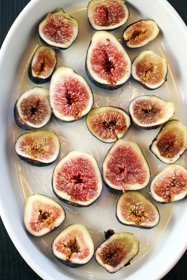 The cut figs go down first in the baking dish.