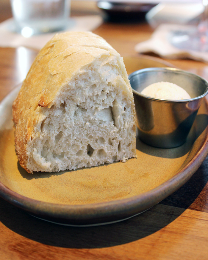 """A server will ask if you would like sourdough bread and butter. It's wise to say """"yes.''"""