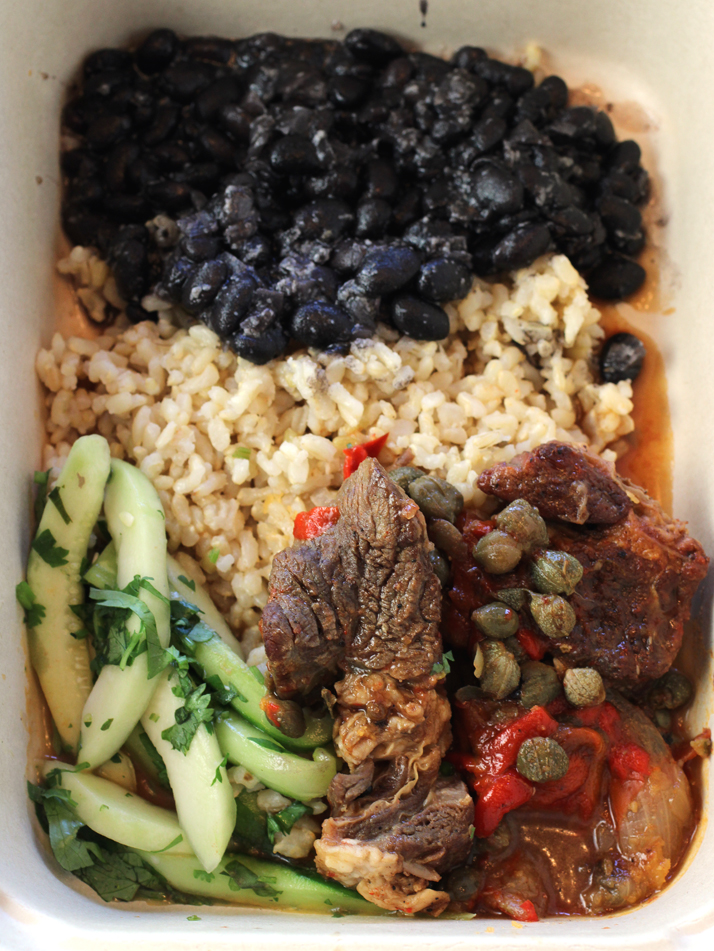 Cuban braised beef -- pick it up hot to eat right away or cold to warm up later at home.