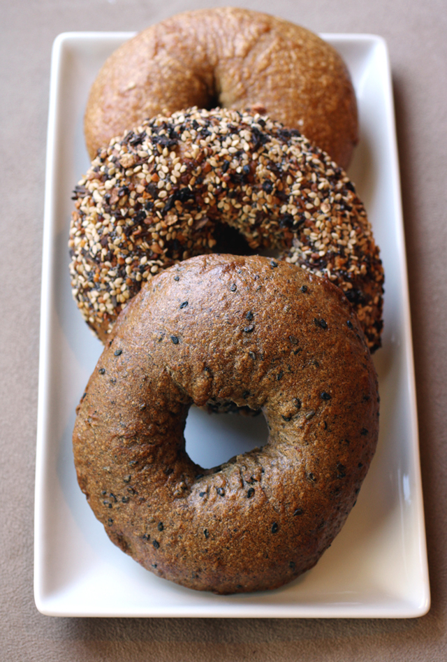 (Front to back): Midnite Bagel's buckwheat-black sesame, Everything, and plain bagels.