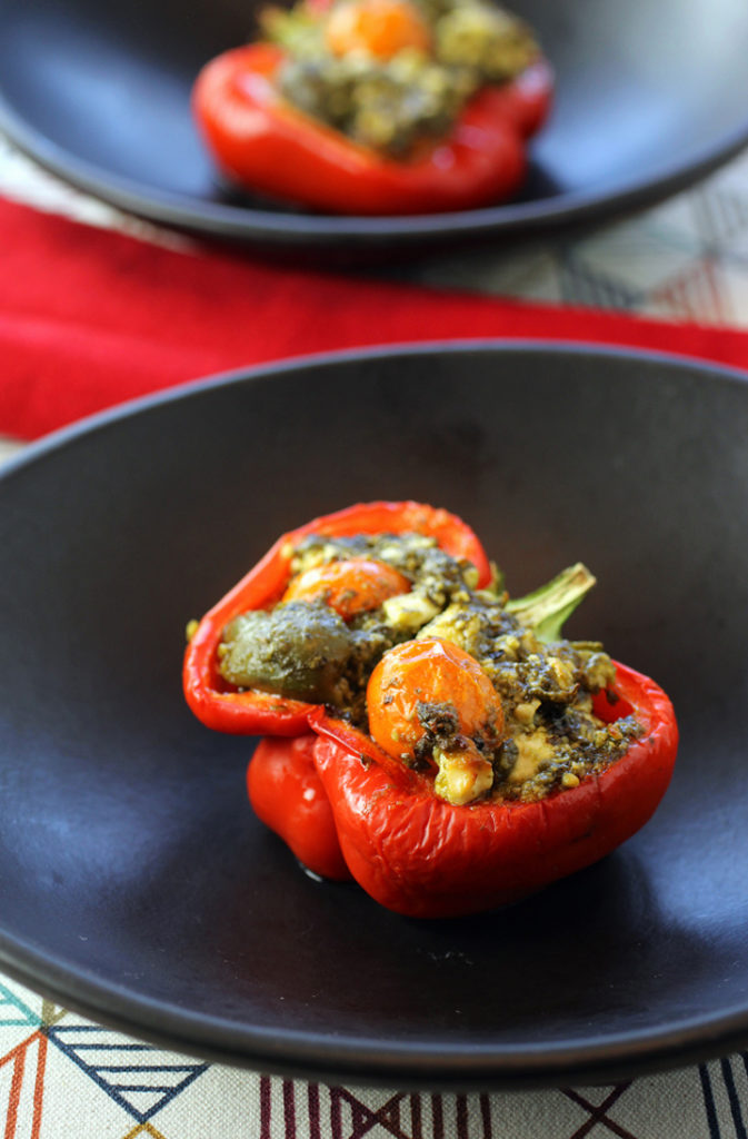 Feta, olives and pesto make up the delectable filling for these stuffed peppers.