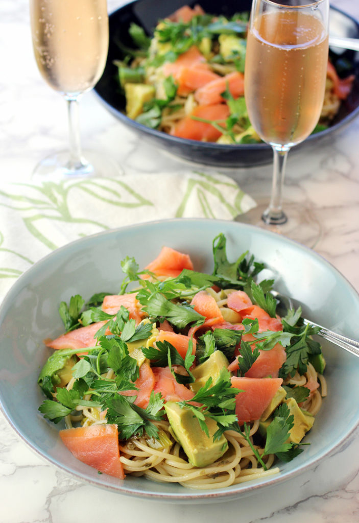 A smoked salmon-avocado pasta with a glass of bubbly -- the makings for one fabulous dinner.